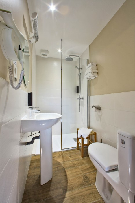 Bathroom with integrated toilet
